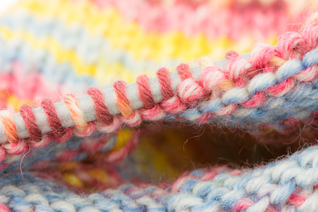 Closeup of loops formed by knitiing on a needle