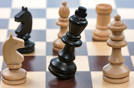 Checkmate - Game of chess with a falling king. Selective focus.