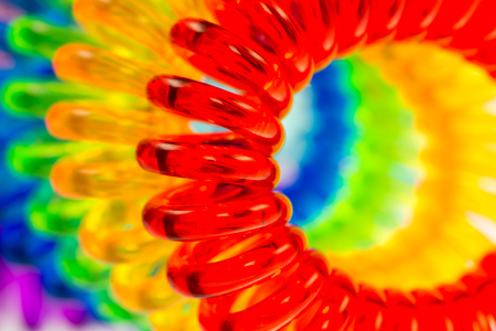 Abstract background of various spiral hair ties with selective focus and shallow depth of field.