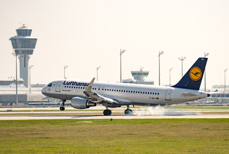 MUNICH, GERMANY - APRIL 9: Plane from Lufthansa  ariline landing on the airport of Munich, Germany on April 9, 2017. The ariport has over 40 million passengers a year. Foto taken from Hallbergmoserstr. Editorial