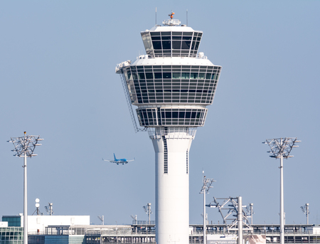 MUNICH, GERMANY - APRIL 9: Control tower of the the airport of Munich, Germany on April 9, 2017. The ariport has over 40 million passengers a year. Foto taken from the visitor platform of the airport. Editorial