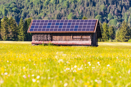 Green energy - barn wih photovoltaic cells on the roof Stock fotó - 80880464