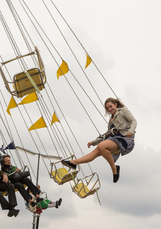MUNICH, GERMANY - SEPTEMBER 19: Unknown girl in a chairoplane on the Oktoberfest in Munich, Germany on September 19, 2017. The Oktoberfest is the biggest beer festival of the world with over 6 million visitors each year.