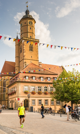 church steeple: VOLKACH, GERMANY - August 20: Tourists at the historic old town of Volkach, Germany on August 20, 2017. Volkach is famous for its annual wine festival. Editorial