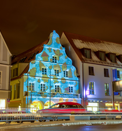 PFAFFENHOFEN, GERMANY - DEZEMBER 17: Illuminated house facades in Pfaffenhofen, Germany on Dezember 17, 2017. In the Advent all houses of the old town are lighted with christmassy pirctures.
