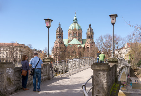 MUNICH, GERMANY - APRIL 4:  Tourists at a bridge to the Saknkt Lukas church in Munich, Germany on April 4, 2018.