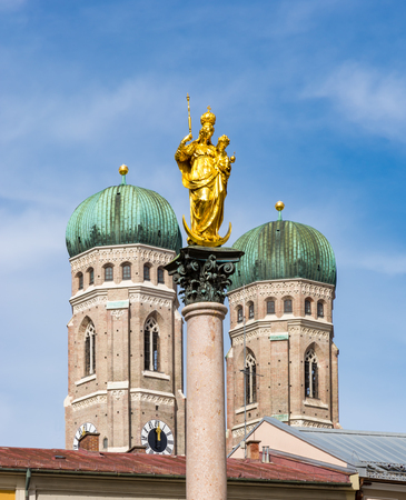 Marian column and the Frauenkirche cathedral of Munich