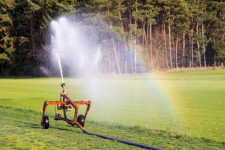 Watering a field with a sprinkler system