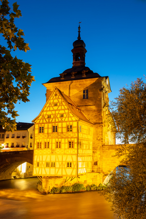 Illuminated historic town hall of Bamberg, built in the 14th century. Stock fotó