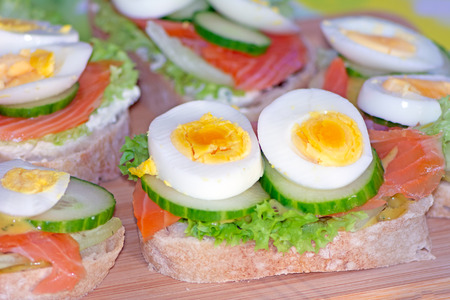 Closeup of a sandwich buffet with salmon and eggs