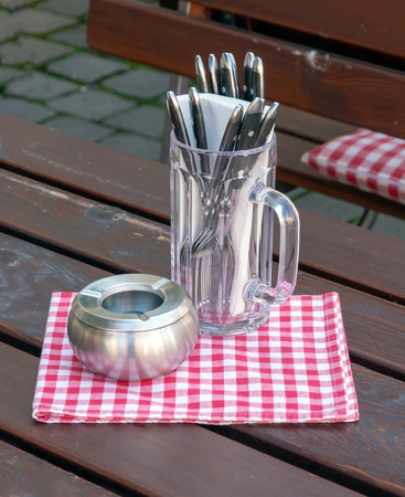 Cutlery and ashtray on the table of a traditional bavarian restaurant Stockfoto