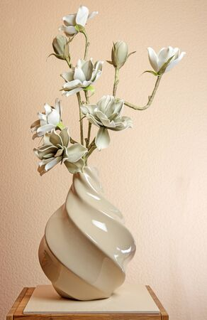 Closeup of artificial magnolia blossoms in a vase