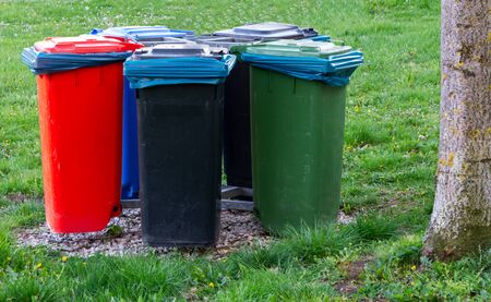 Garbage cans for waste separation and recycling in a park Foto de archivo