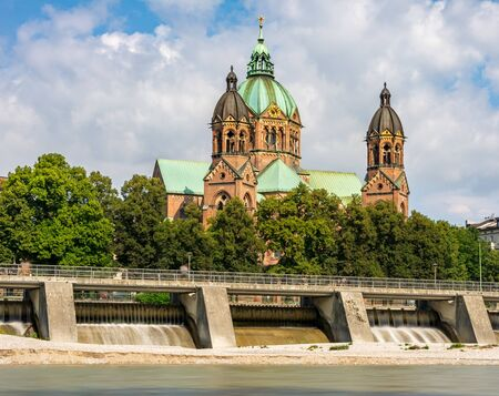 Sankt Lukas church in Munich at the river Isar (Bavaria, Germany) 写真素材