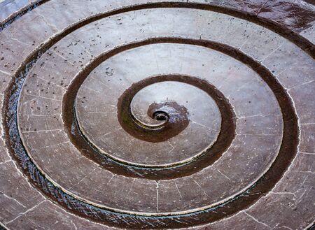 Closeup of water flowing in a sprial fountain Zdjęcie Seryjne