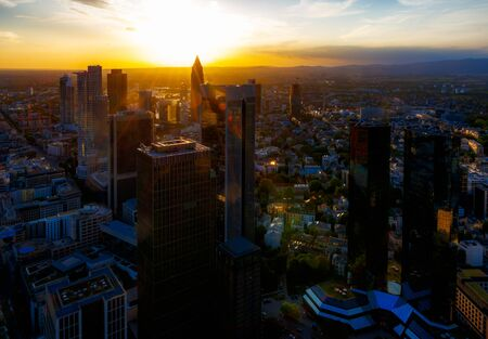 Aerial view over the skyscrapers of  Frankfurt (Germany) at sunset
