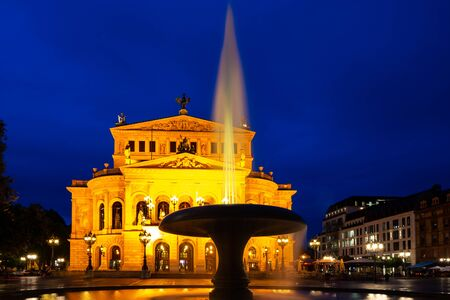 Illuminated old opera house in Frankfurt at night 스톡 콘텐츠