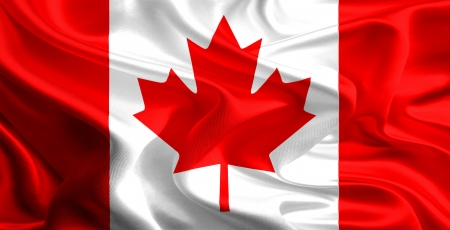canadian icon: Waving Fabric Flag of Canada Stock Photo