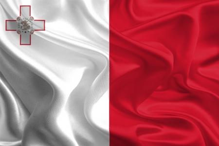 malta flag: Waving Fabric Flag of Malta Stock Photo