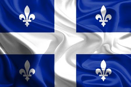 Waving Stof Vlag van Quebec, Canada Stockfoto