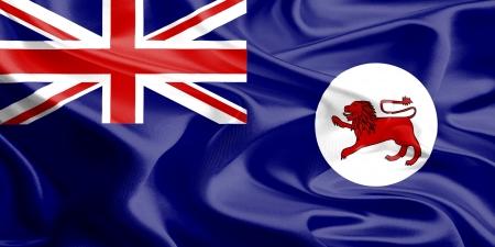 tasmania: Waving Fabric Flag of Tasmania  ,Australia Stock Photo