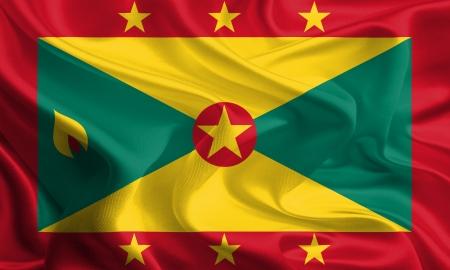 grenada: Waving Fabric Flag of Grenada Stock Photo
