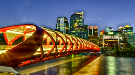 foot bridges: Calgary Peace bridge over bow river with downtown view
