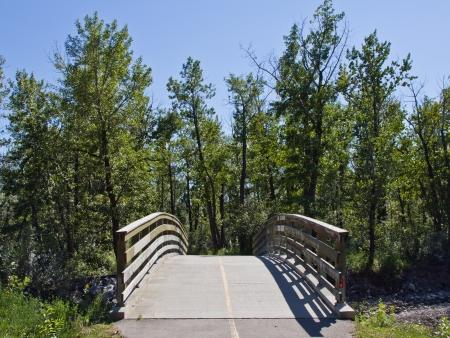 provincial forest parks: a bridge in Fish Creek Park, Calgary Alberta  Canada  Stock Photo