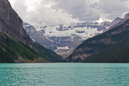 louise: A Cloudy Day at Famous Lake Louise in Banff National Park, Alberta, Canada  Stock Photo