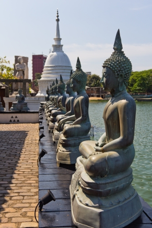 Famous sitting Buddha statues and stupa in the Seema Malaka Temple in Colombo  This is situated on Beira Lake and is part of the Gangaramaya Buddhist Temple Complex  photo