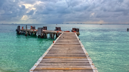 boat bridge  tower on Cancun beach photo