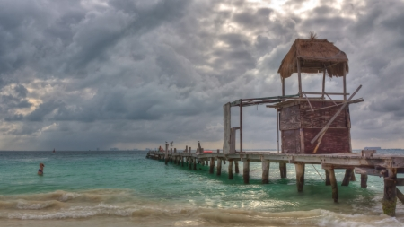 boat bridge and a watch tower on Cancun beach photo