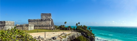 Ancient Mayan ruins in Tulum on the beach of Caribbean turquoise sea  photo