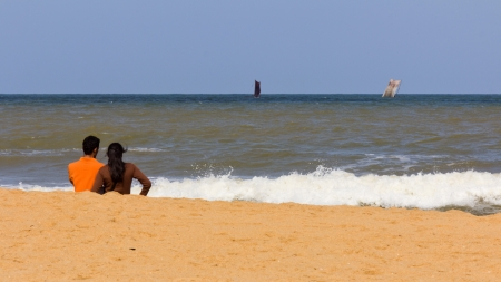 couple enjoying sailboat sailing in Indian ocean horizon near Sri Lanka  photo