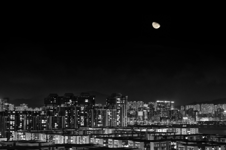 Moon over apartment buildings in Kowloon area, Hong Kong