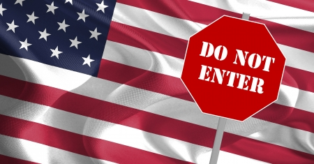 DO NOT ENTER message on stop board with USA flag in the background photo