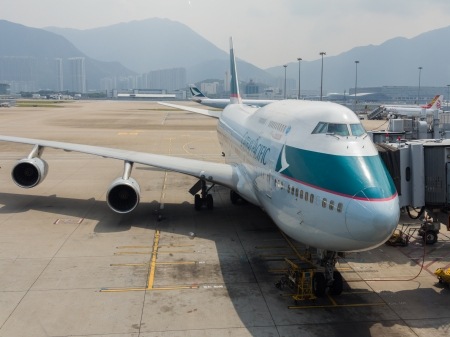 Cathay Pacific Boeing 747-400ready for boarding in Hong Kong Airport on Oct 9, 2013  Cathey Pacific was founded in 1946 and became one of the famous airline in Hong Kong