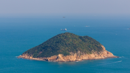 Isolated Island in Clearwater Bay Area in  Hong Kong, China in a misty day photo