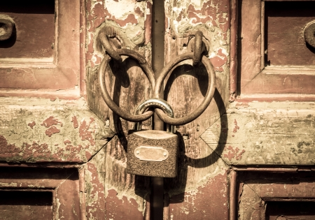Closeup metal door with lock in grungy style photo
