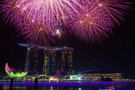 new year s eve: New year eve fireworks at Marina Bay Sands Resort Hotel in Singapore  It is billed as the world s most expensive standalone casino property