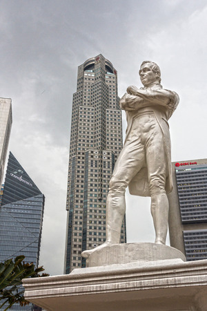 Sir Raffles statue with modern skyscrapers on background, Singapore  photo