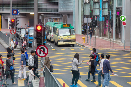 People are using phone while crossing the road, captured in Tuen Mun, Hong Kong, China
