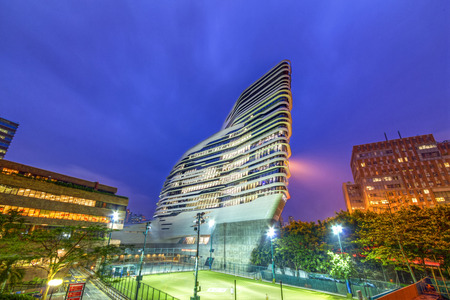 Night view of the Jockey Club Innovation Tower is home to Hong Kong Polytechnic University s School of Design  Designed by Pritzker-prize-winning architect Zaha Hadid