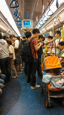 Unidentified passengers ride the subway in Hong Kong  The MTR consists of 218 2 km of rail with 152 stations