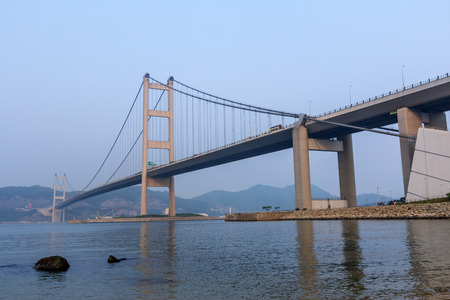 View of Tsing Ma Bridge from Park Island in Hong Kong  photo