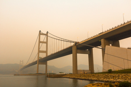 View of Tsing Ma Bridge at Sunset from Park Island in Hong Kong  photo