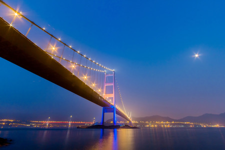 Night View of Tsing Ma Bridge from Park Island in Hong Kong  photo