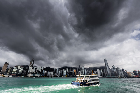 View of Victoria harbor just before a tropical cyclone  During summer, typhoons regularly skirt the city, causing varying degrees of damage including injuries and deaths  Editorial