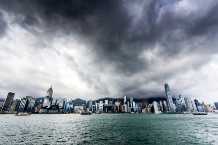 View of Victoria harbor just before a tropical cyclone  During summer, typhoons regularly skirt the city, causing varying degrees of damage including injuries and deaths  Stock Photo