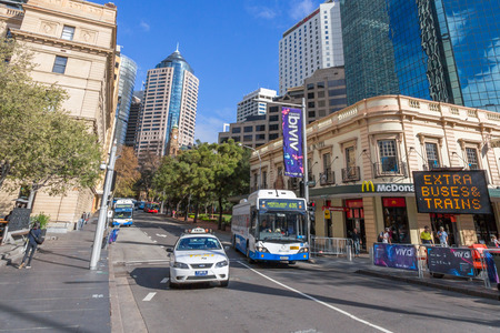 Buses and taxis in Sydney Circular Quay  Sydney s public transport system features a comprehensive network of train, bus and ferry services   Editorial